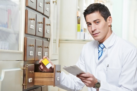 Pharmacy chemist man in drugstore Stock Photo - 12589435