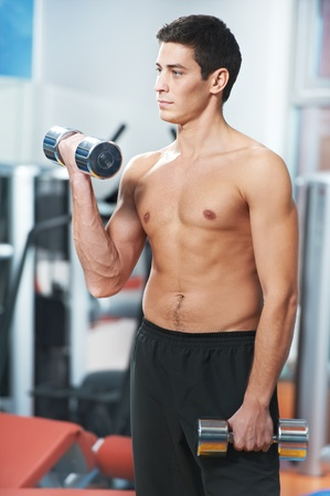 man doing biceps muscle exercises in gym photo