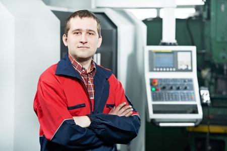 experienced operator: worker operating CNC machine center Stock Photo