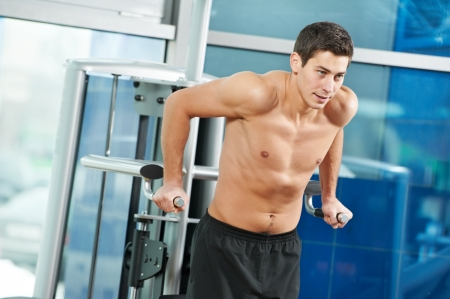 bodybuilding man at arm muscles exercises photo