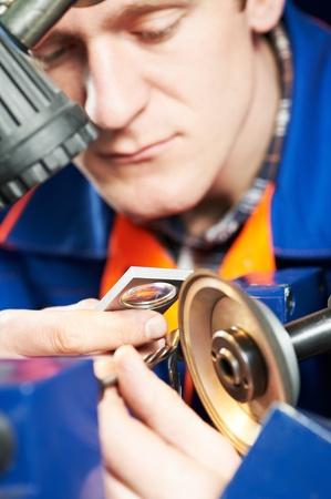 sharpening: worker measuring detail