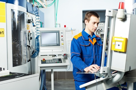 worker at machine tool in workshop Stock Photo - 12589603