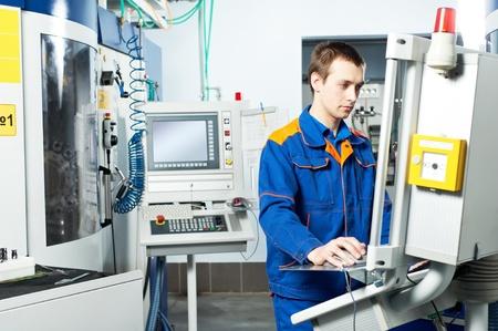 machine man: worker at machine tool in workshop