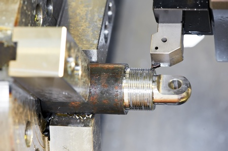 on the lathe: Close-up process of metal machining by threading Stock Photo