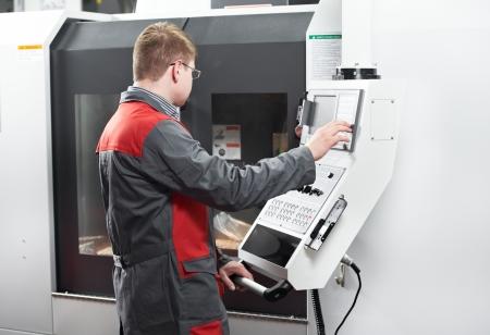 machining center: laborer working with machine tool