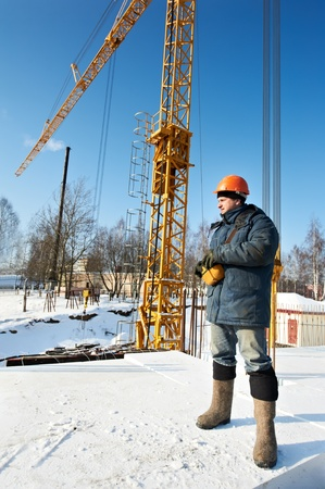 work wear: worker with tower crane remote control equipment