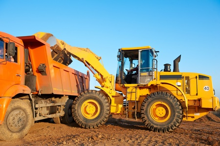 digging: wheel loader excavator and tipper dumper Stock Photo