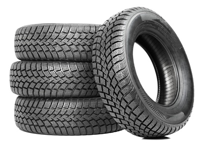 tyre tread: Stack of four car wheel winter tires isolated