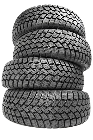 four wheel drive: Stack of four car wheel winter tires isolated