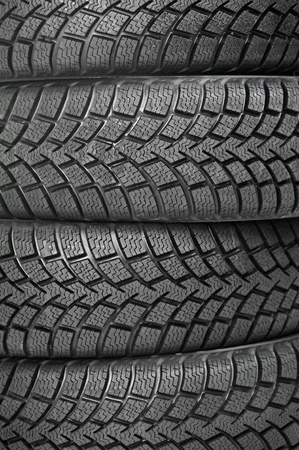 Background of four car wheel winter tires photo