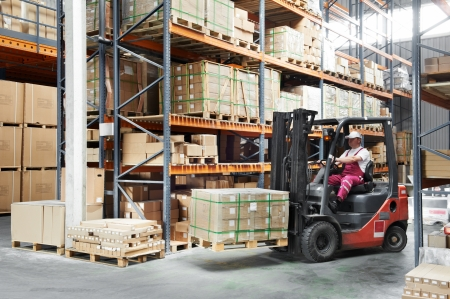 warehouse equipment: worker driver at warehouse forklift loader works