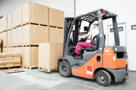 forklift driver: worker driver at warehouse forklift loader works