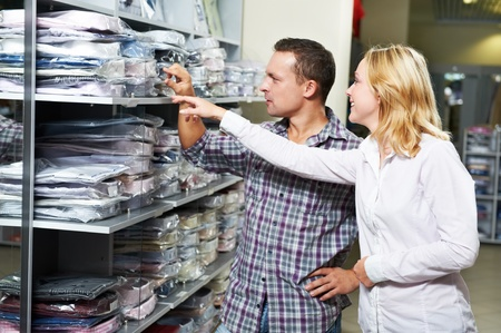 Young couple people at clothes shopping photo