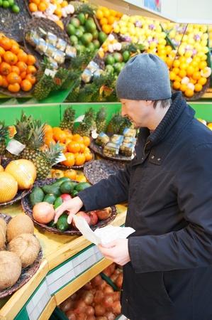 wholesale: man choosing vegetables in supermarket store