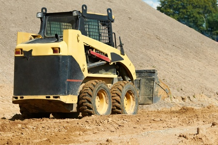 skid steer loader at earth moving works Stock Photo - 12648721