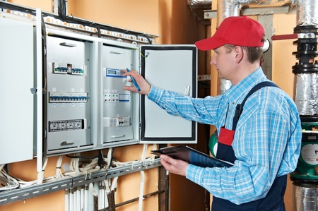 manual test equipment: Electrician checking data Stock Photo