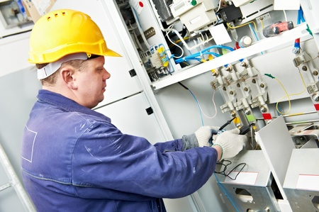 electrician: Electrician measure voltage  Stock Photo