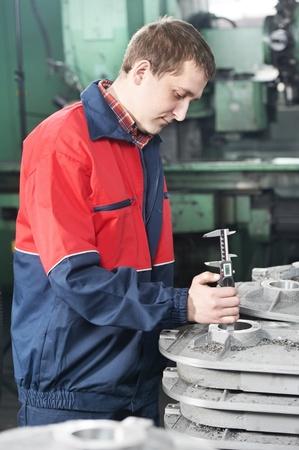 sliding caliper: worker measuring detail tool Stock Photo