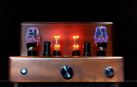 electronic amplifier with glowing bulb lamp photo