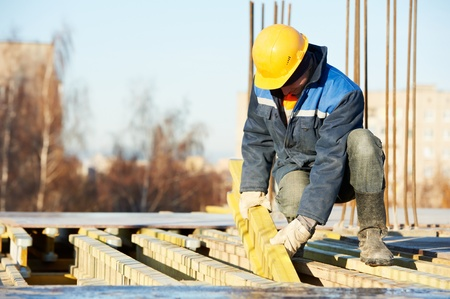 concrete form: construction worker preparing formwork