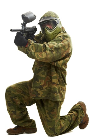 Aiming paintball player photo