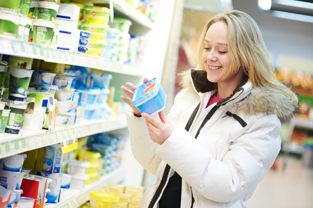 woman making dairy shopping Stock Photo - 12590123
