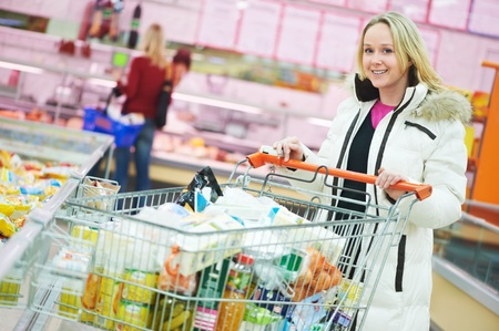 purchaser: woman at supermarket dairy shopping