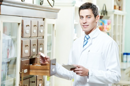 Pharmacy chemist man in drugstore Stock Photo - 12872286