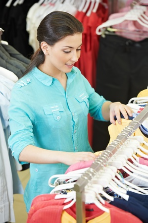 Young woman at shirts clothes shopping photo