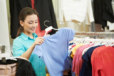 Young woman at apparel clothes shopping Stock Photo - 12872245