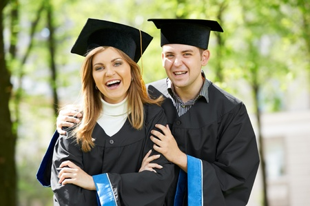 graduate students on grass Stock Photo - 12872878