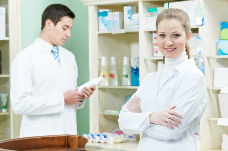 Two Pharmacy chemist workers in drugstore photo