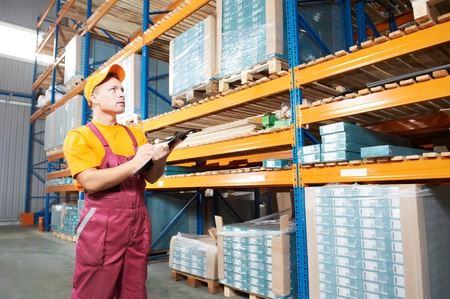 wholesale: manual worker inspector in warehouse Stock Photo