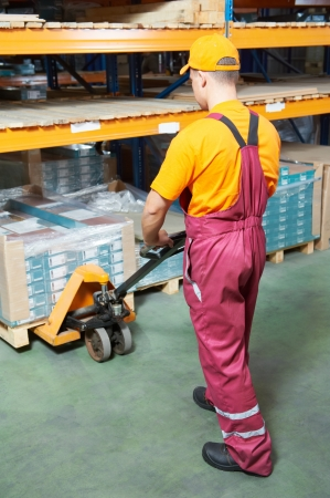 worker with fork pallet truck Stock Photo - 12875283