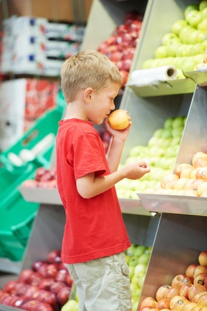 child boy making fruits vegetable shopping photo