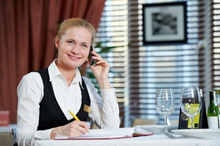reservation: restaurant manager woman at work place