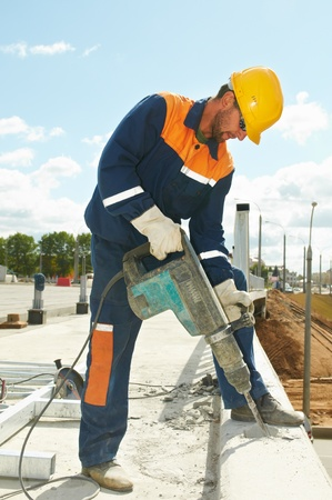 portrait of construction worker with perforator photo
