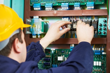 Electrician at safety fuse device replace work photo