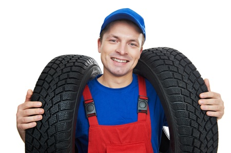 tire fitting: automobile mechanic with car tire