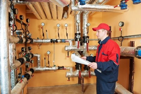 heating engineer repairman in boiler room photo