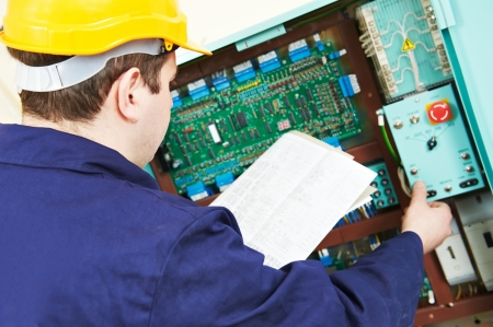 electrical contractor: Electrician with drawing at power line box