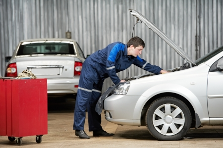 service car: car mechanic diagnosing auto engine problem