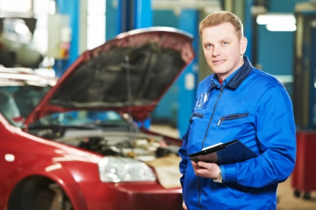 scheduled replacement: happy mechanic technician at service station