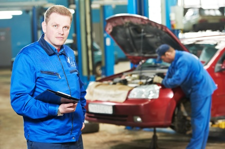scheduled: happy mechanic technician at service station