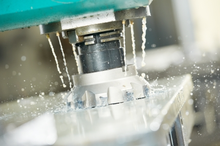 affixment: Close-up process of metal machining by mill Stock Photo
