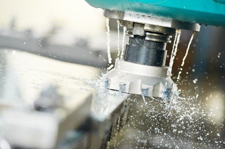 Close-up process of metal machining by mill Stock Photo - 13094767