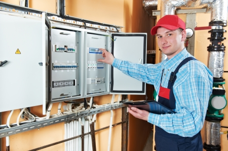 technical service: Electrician checking data Stock Photo