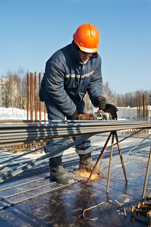 erecting: builder works with concrete reinforcement Stock Photo