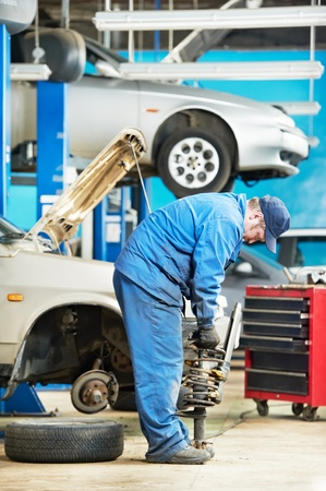 mechanician: machanic repairman at carriage spring adjustment Stock Photo