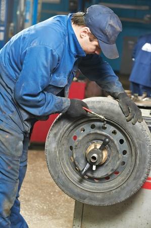 machanic repairman at tyre balancing adjustment Stock Photo - 13097892